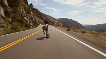 Watch a Skateboarder Blast Down a Hill at Warp Speed