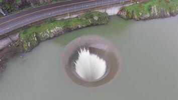 "Mesmerizing Drone Footage Shows ""Whirlpool"" Draining This Lake"
