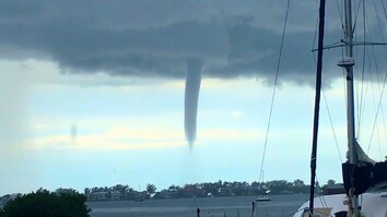 Watch: Twin Waterspouts Spin Over Residential Beach