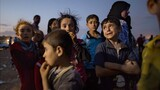 Fleeing ISIS Conflict: Photographing Refugees