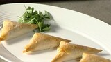 Caramelized Onion, Prune and Feta Triangles