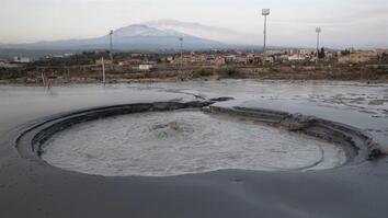 Can This Bubbling Pit Of Mud Really Predict a Volcanic Eruption?