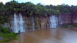 This Empty Quarry Transformed Into a Waterfall-Filled Lake
